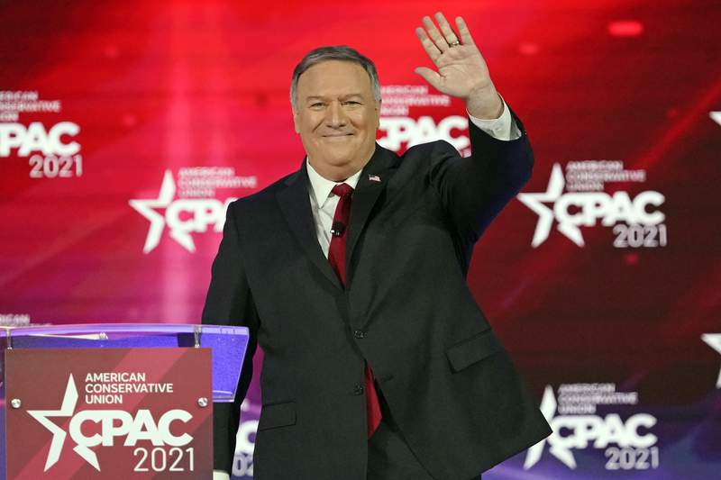 FILE - 70th United States Secretary of State Mike Pompeo waves as he is introduced at the Conservative Political Action Conference (CPAC) on Feb. 27, 2021, in Orlando, Fla. From the point of view of C-SPAN, the 2024 presidential campaign begins this Friday, March 26, 2021. The network is sending it cameras to suburban Des Moines, Iowa, to tape Pompeo speaking to a breakfast meeting of the Westside Conservative Club, to be aired later in the day on Friday. (AP Photo/John Raoux, File)