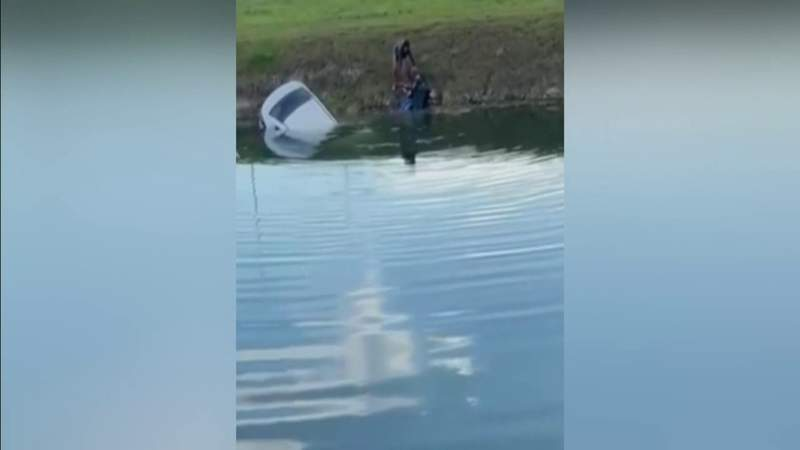 Man jumps into canal, pulls driver to safety following crash