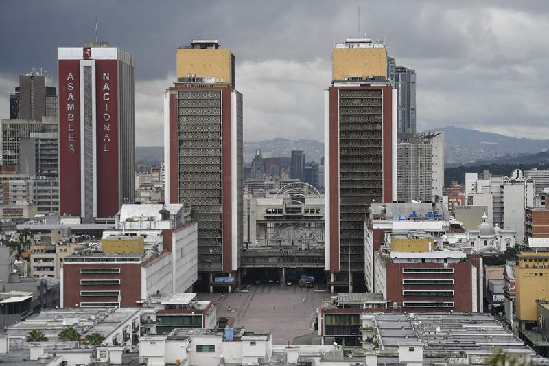 A view of an almost empty Plaza Caracas, and the National Assembly building in Caracas, Venezuela, Saturday, Aug. 1, 2020, amid the new coronavirus pandemic. (AP Photo/Matias Delacroix)
