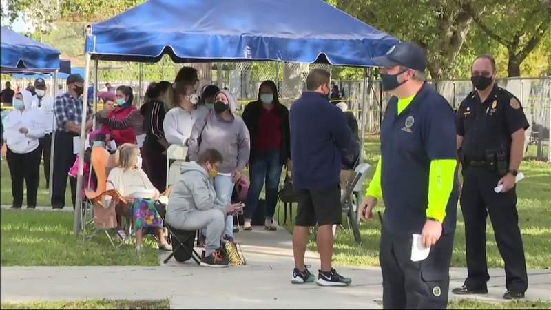 Miami residents line up early to receive $250 gift cards to Publix