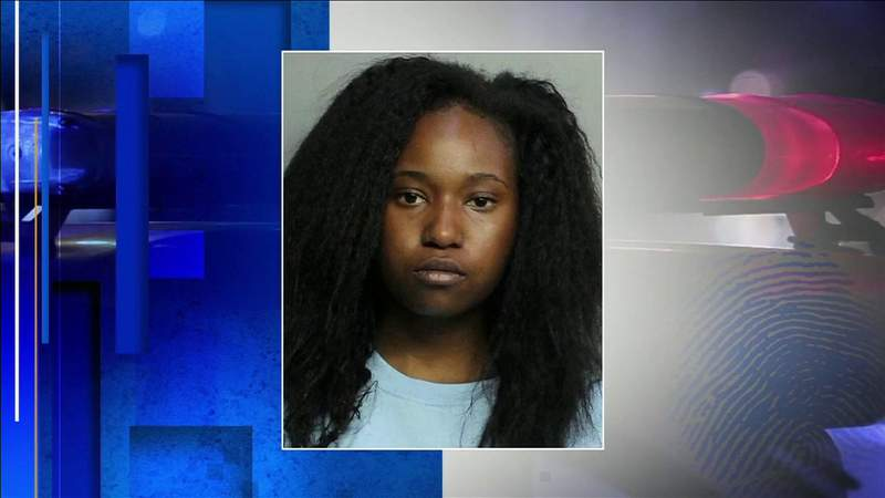Woman booked into jail after being charged with running over police officer