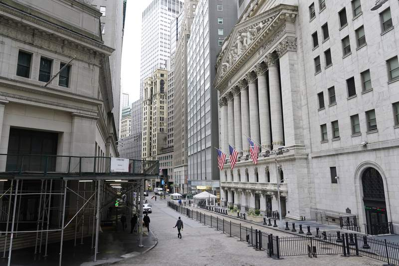 FILE - This Nov. 23, 2020 file photo shows the New York Stock Exchange in New York.  U.S. stocks are ticking higher on Friday, Jan. 8, 2021, despite a sober reminder of how many jobs the pandemic is destroying, as Wall Street keeps focusing more on the economys potentially brighter future than its current pain. (AP Photo/Seth Wenig)
