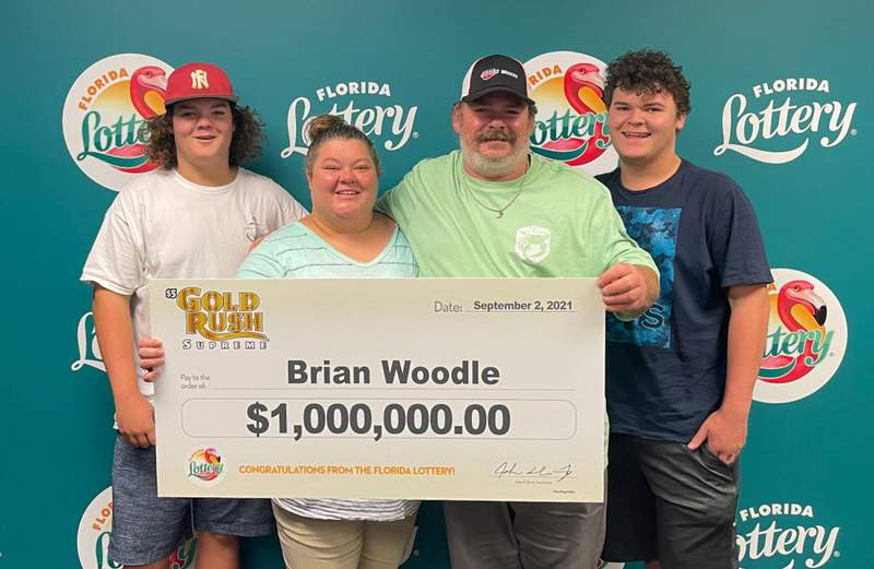 Brian Woodle opened his own auto repair shop and then won $1 million on a scratch-off -- all in a day's work.