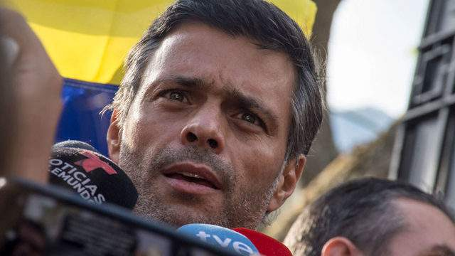 Opposition Leader Leopoldo Lopez speaks to reporters at the gate of the Spanish ambassador's residence on Thursday in Caracas, Venezuela. Photo by Rafael Briseño/Getty Images