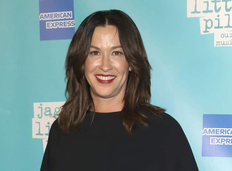 """FILE - Alanis Morissette attends the """"Jagged Little Pill"""" Broadway opening night in New York on Dec. 5, 2019. Just hours before the HBO documentary Jagged was to premiere at the Toronto International Film Festival on Tuesday, Alanis Morissette criticized the film about her life as reductive and salacious. Morissette participated in the film, directed by Alison Klayman, sitting for lengthy interviews. But in a statement issued by her publicist, Morissette said she would not be supporting the film. (Photo by Greg Allen/Invision/AP, File)"""