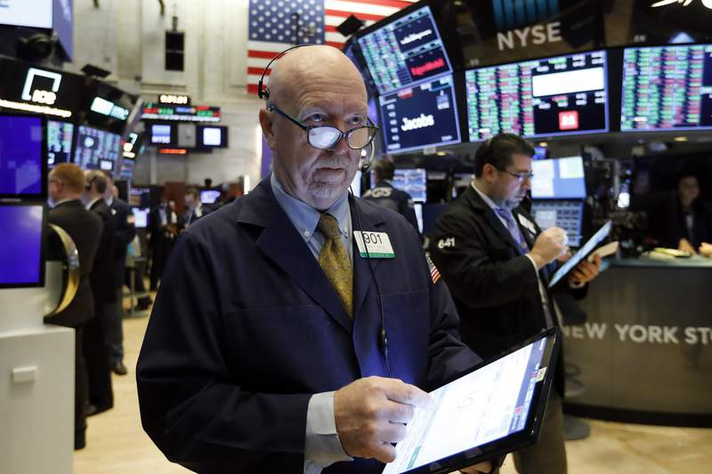 FILE - In this Feb. 6, 2020, file photo trader John Doyle works on the floor of the New York Stock Exchange. The U.S. stock market opens at 9:30 a.m. EST on Friday, Feb. 21. (AP Photo/Richard Drew, File)
