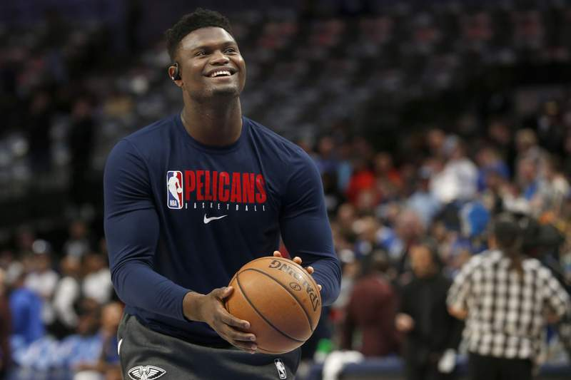 FILE - In this March 4, 2020, file photo, New Orleans Pelicans forward Zion Williamson shoots free throws prior to an NBA basketball game against the Dallas Mavericks in Dallas. The New Orleans Pelicans say top overall draft choice Zion Williamson has left the club to attend to an urgent family medical matter. The Pelicans say Williamson intends to rejoin the team in the Orlando area for the resumption of the season. But the club has not said whether the former Duke star would be able to return or whether hell miss any games because of his departure on Thursday, July 16, 2020. (AP Photo/Michael Ainsworth, File)