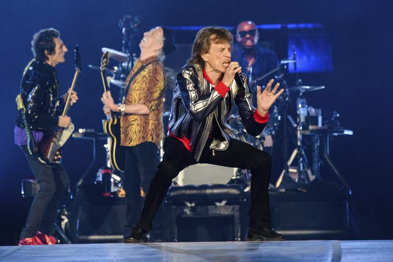 """Ronnie Wood, from left, Keith Richards, Mick Jagger and Steve Jordan of the Rolling Stones perform during the """"No Filter"""" tour at The Dome at America's Center, Sunday, Sept. 26, 2021, in St. Louis. (Photo by Amy Harris/Invision/AP)"""