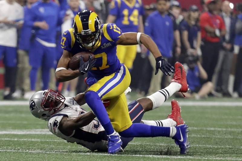 FILE - In this Feb. 3, 2019, file photo, Los Angeles Rams' Robert Woods (17) breaks a tackle by New England Patriots' Jonathan Jones (31) during the second half of the NFL Super Bowl 53 football game in Atlanta. A person with knowledge of the deal says receiver Woods has agreed to a four-year contract extension worth up to $68 million with the Rams. The person spoke to The Associated Press on condition of anonymity because the Rams announced the deal Friday, Sept. 18, 2020, without revealing the financial terms. (AP Photo/Lynne Sladky, File)