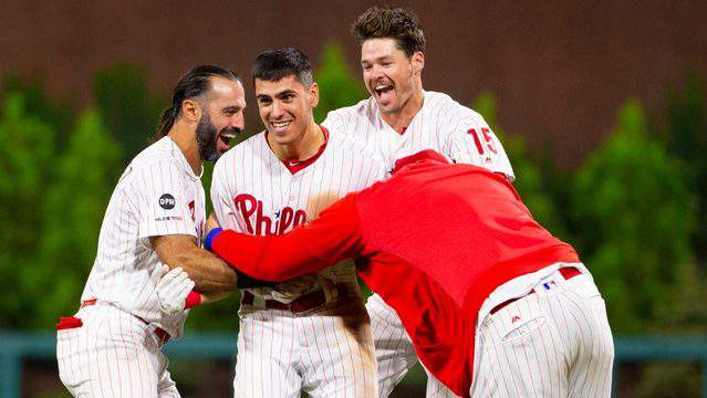 Philadelphia's Adam Haseley celebrates with teammates after hitting a game-winning fielder's choice in the bottom of the 15th inning against the Miami Marlins at Citizens Bank Park on Sept. 27, 2019 in Philadelphia.