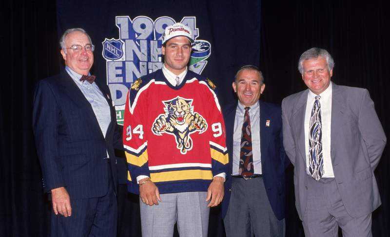 Florida Panthers General Manager Bill Torrey poses with Canadian hockey player Ed Jovanovski shortly after the Panthers selected Jovanovski as the first overall pick at the NHL Entry Draft, Hartford, Connecticut, 1994.