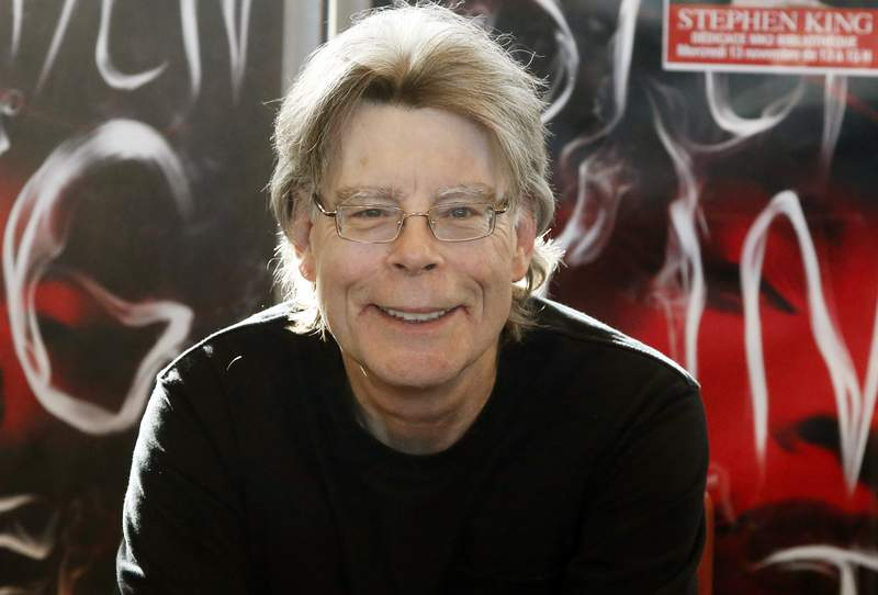 FILE - In this Nov. 13, 2013 file photo, author Stephen King poses for the cameras, during a promotional tour in Paris. Readers may know him best for Carrie, The Shining and other bestsellers commonly identified as horror, but King has long had an affinity for other kinds of narratives, from science fiction and prison drama to the Boston Red Sox.   (AP Photo/Francois Mori, File)