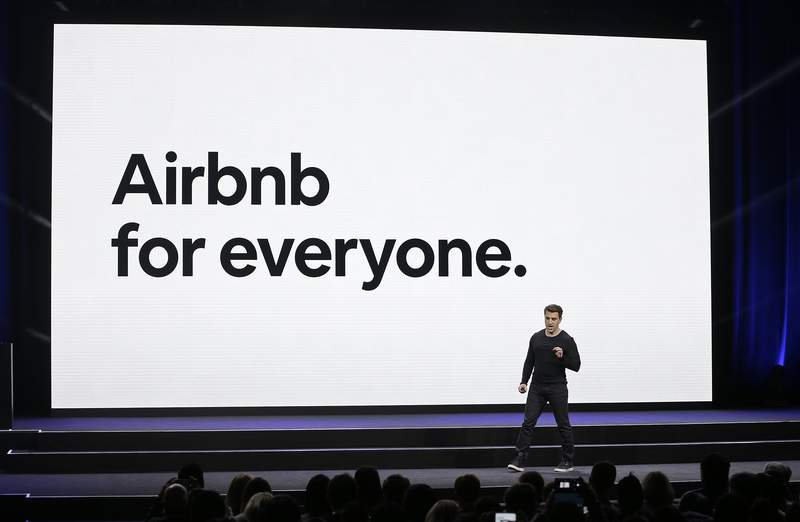 FILE - In this Feb. 22, 2018, file photo, Airbnb co-founder and CEO Brian Chesky speaks during an event in San Francisco. Airbnb hopes to raise as much as $2.6 billion in its initial public stock offering this month, betting investors will see its home-sharing model as the future of travel. In a government filing Tuesday, Dec. 1, 2020, the San Francisco-based company said it expects to offer 51.9 million common shares priced between $44 and $50 per share. (AP Photo/Eric Risberg, File)
