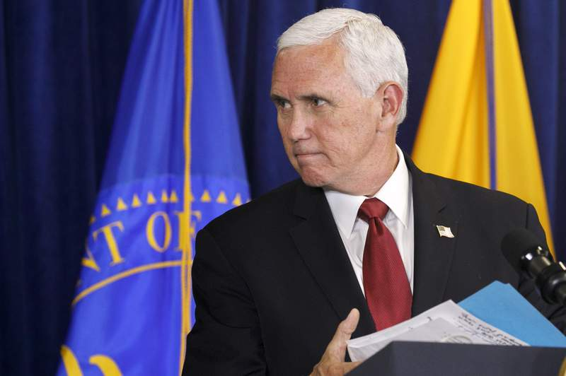 Vice President Pence leaves the podium after speaking to the Commissioned Corps of the U.S. Public Health Service at their headquarters in Rockville, Md., Tuesday, June 30, 2020. (AP Photo/Jacquelyn Martin)