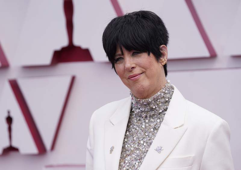 File-This April 25, 2021, file photo shows Diane Warren arriving at the Oscars at Union Station in Los Angeles.  Warren stepped in Thursday, June 24, 2021, to save the life of cow that eluded capture for more than a day after a herd escaped from a Southern California slaughterhouse and stampeded through a suburb.  The Grammy-winning artist contacted the city of Pico Rivera to arrange to have the cow sent to the Farm Sanctuary north of Los Angeles, Warren and City Manager Steve Carmona said. (AP Photo/Chris Pizzello, Pool, File)