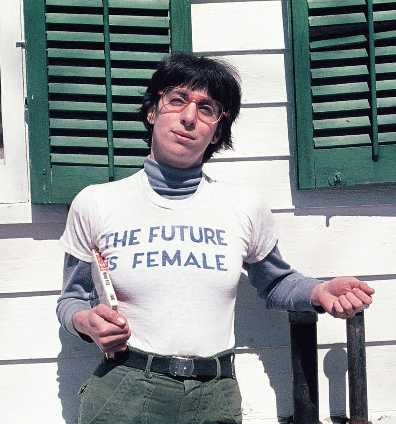 """Alix Dobkin poses in a t-shirt that reads """"The Future is Female"""" in Preston Hollow, N.Y. in 1975. Dobkin, the lesbian singer and feminist activist, died in her home from a brain aneurysm and stroke. She was 80. (Liza Cowen via AP)"""