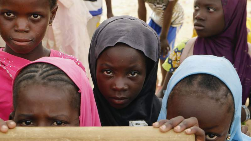 Displaced children attend class in Dori town, Burkina Faso, Saturday Aug. 7, 2021. The Norwegian Refugee Council said Burkina Fasos slow and insufficient humanitarian response to the countrys escalating attacks is forcing people to choose between violence or hunger. Surging violence linked to al-Qaida and the Islamic State in the war-weakened West African nation has forced more than 275,000 people from their homes since April _ double those displaced in the previous seven months, according to government statistics. (AP Photo/Sam Mednick)