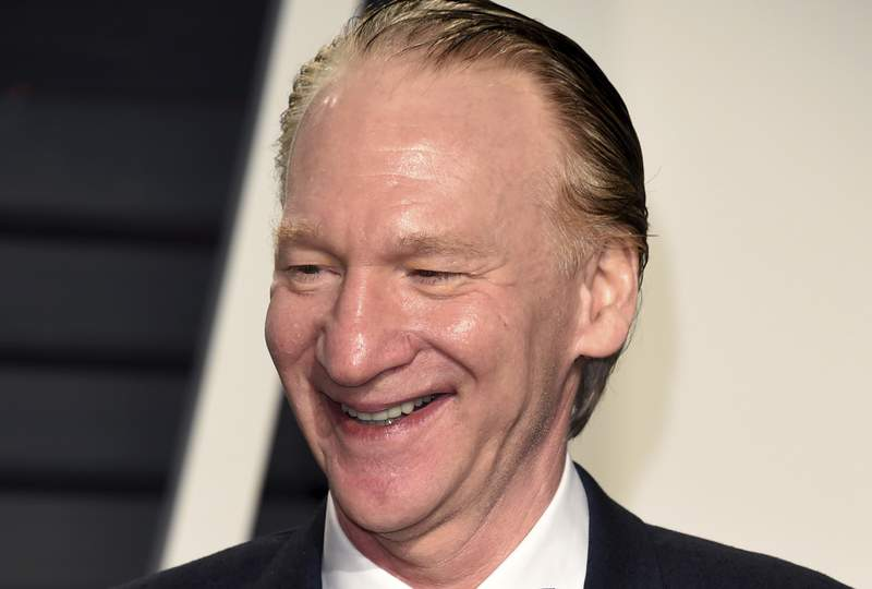 """FILE - In this Sunday, Feb. 26, 2017, file photo, Bill Maher arrives at the Vanity Fair Oscar Party in Beverly Hills, Calif. A taping of Maher's weekly HBO show was cancelled after the host tested positive for COVID. Maher, who is fully vaccinated, is asymptomatic and feels fine,"""" according to a statement Thursday, May 13, 2021, from HBO. (Photo by Evan Agostini/Invision/AP, File)"""