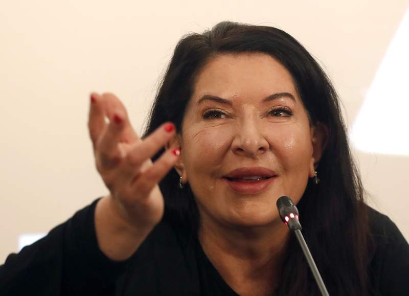 FILE - In this Sept. 21, 2019 file photo, performance artist Marina Abramovic speaks during a press conference in Belgrade, Serbia. A Spanish foundation, the Princess of Asturias awarded Serbian performance artist Marina Abramovic one of the European nation's most prestigious awards for the fine arts on Wednesday May 12, 2021. (AP Photo/Darko Vojinovic, File)
