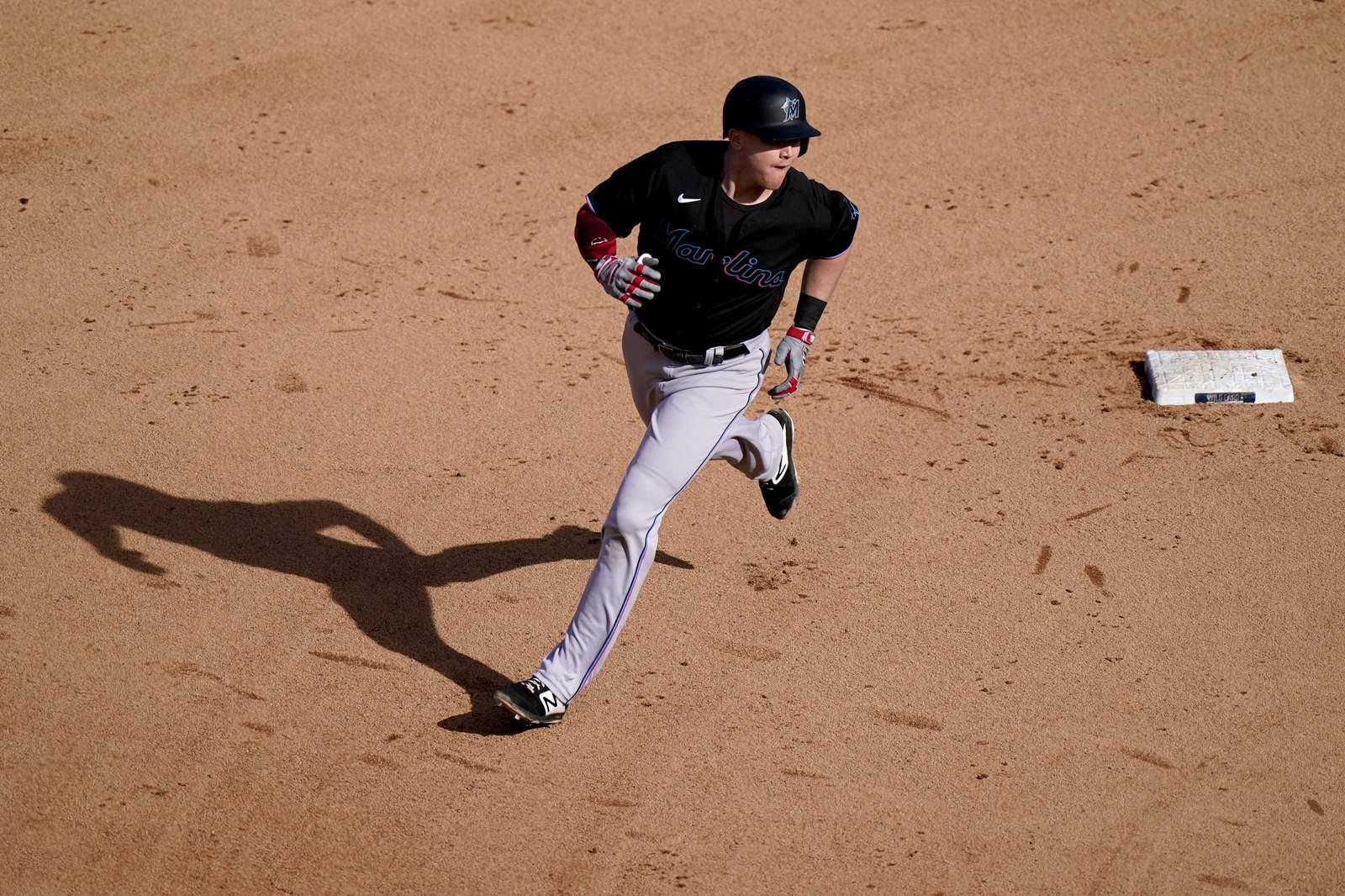 Marlins knock off Cubs, advance to NLDS vs. Braves