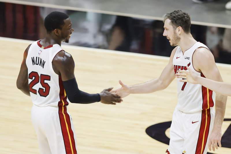 Kendrick Nunn of the Miami Heat celebrates wtith Goran Dragic during their game against the Houston Rockets in the fourth quarter at American Airlines Arena on April 19, 2021 in Miami, Florida.