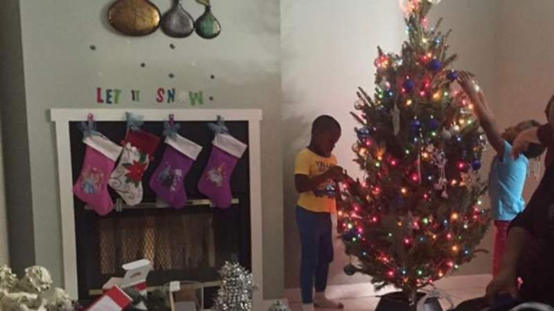 Takiya Brown decorates a Christmas tree at a Miami-Dade foster care group home in 2015.