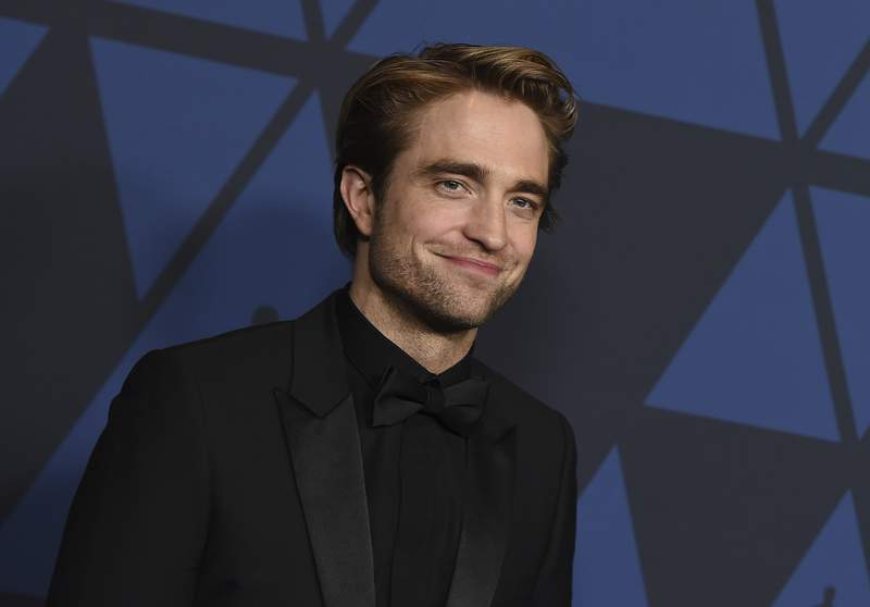FILE - This Oct. 27, 2019 file photo show actor Robert Pattinson at the Governors Awards in Los Angeles. Warner Bros. is delaying a batch of releases including The Batman and The Sopranos prequel The Many Saints of Newark. The studio said Monday, April 20, 2020 that The Sopranos film will be pushed from September 2020 to a March 2021 release, while The Batman starring Pattinson will be delayed four months to October 2021.  (Photo by Jordan Strauss/Invision/AP, File)