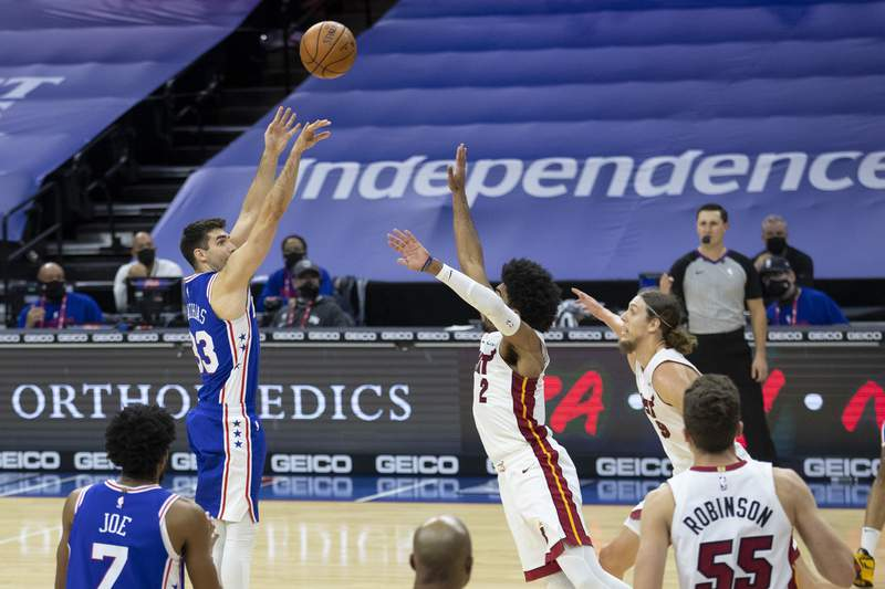 Dakota Mathias #33 of the Philadelphia 76ers shoots the ball in the final moments of overtime during their game against the Miami Heat at the Wells Fargo Center on January 12, 2021 in Philadelphia, Pennsylvania. The 76ers defeated the Heat 137-134.