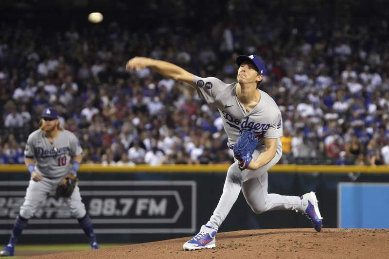 Los Angeles Dodgers pitcher Walker Buehler throws against the Arizona Diamondbacks in the first inning during a baseball game, Saturday, June 19, 2021, in Phoenix. (AP Photo/Rick Scuteri)