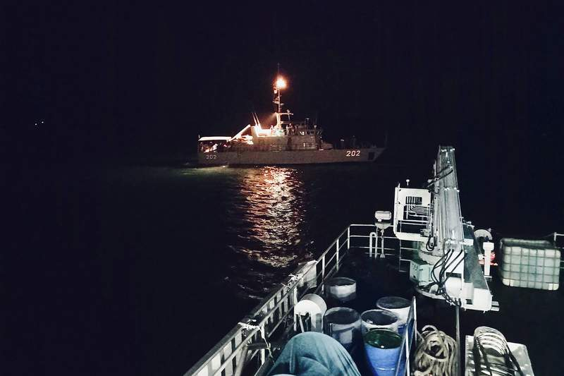 In this photo released by Republic of Fiji Navy, Fijian naval patrol boat RFNS Kikau (202) advances to search for crew members who jumped overboard from a fishing boat in Fiji waters Thursday, May 20, 2021. Authorities on Friday, May 21, 2021 said they feared for the lives of five crew members who had leapt from their fishing boat near Fiji earlier this week after an alleged violent incident on board. A sixth person who abandoned the vessel was found alive Thursday aboard an overturned life raft while two more people who had remained aboard the fishing boat were due to be picked up a military patrol boat. (Republic of Fiji Navy via AP)