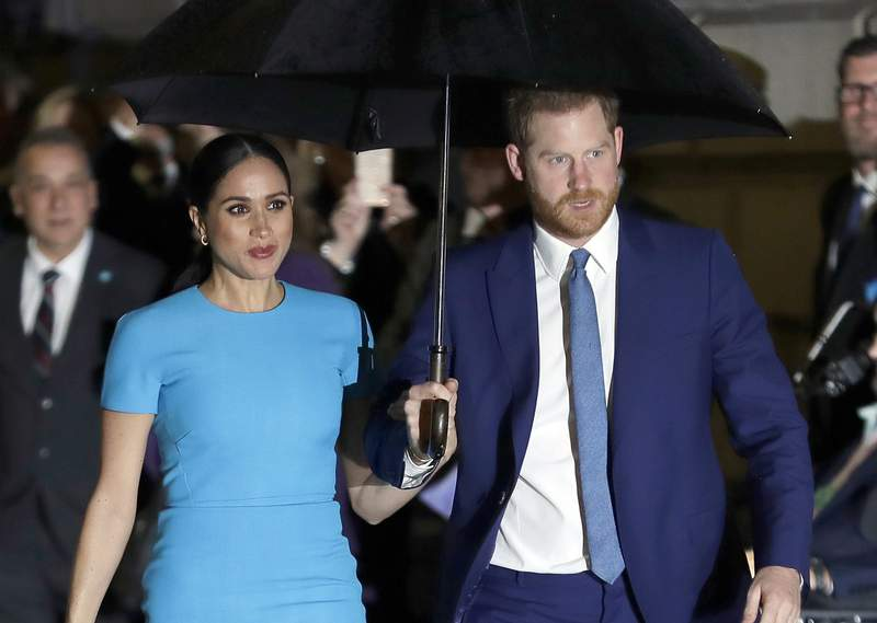 FILE - In this March 5, 2020 file photo, Britain's Prince Harry and Meghan, Duchess of Sussex arrive at the annual Endeavour Fund Awards in London. In a video interview with the Evening Standard newspaper published Thursday Oct. 1, 2020, Prince Harry has spoken about his awakening to race issues as he and his wife, Meghan, launched an anti-racism campaign to mark Black History Month in the U.K. (AP Photo/Kirsty Wigglesworth, File)