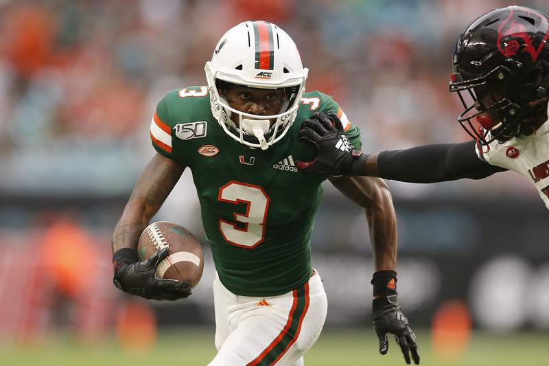Mike Harley #3 of the Miami Hurricanes in action against the Louisville Cardinals during the first half at Hard Rock Stadium on November 09, 2019 in Miami, Florida.