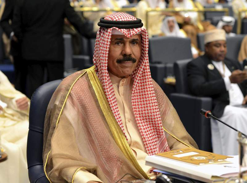 FILE - In this Wednesday, March 26, 2014 file photo, Kuwait's Crown Prince Sheik Nawaf Al-Ahmad Al-Jaber Al-Sabah attends the closing session of the 25th Arab Summit in Bayan Palace in Kuwait City. Kuwait's Crown Prince Sheikh Nawaf Al Ahmad Al Sabah became the oil-rich nation's new ruling emir Tuesday, Sept. 29, 2020, state media reported, reaching the highest post in the country after decades in its security services. (AP Photo/Nasser Waggi, File)