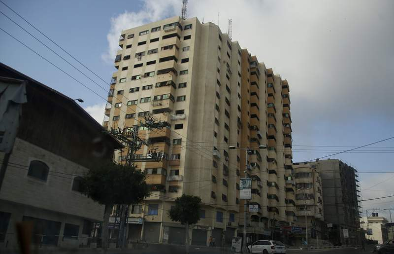 A view showing damage to the Al-Andalus tower in north Gaza City, which was hit by multiple Israeli airstrikes, Thursday, May 20, 2021. (AP Photo/Hatem Moussa)