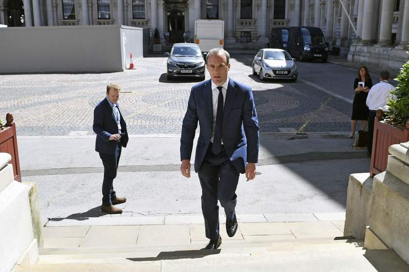 """Britain's Foreign Secretary Dominic Raab arrives at the Foreign and Commonwealth Office in London, Thursday May 28, 2020. Raab has signed a joint statement urging China to work with the government of Hong Kong to find a """"mutually acceptable accommodation that will honour China's international obligations"""" under the Joint Declaration. (Stefan Rousseau/PA via AP)"""