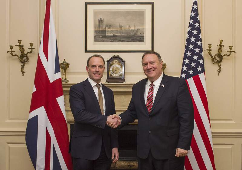 UK Foreign Secretary Dominic Raab shakes hands with US Secretary of State Mike Pompeo, right, in London, Wednesday Jan. 29, 2020.  Pompeo is in the UK for high level trade talks ahead of Britain's exit from the European Union on upcoming Friday. (Peter Summers/Pool via AP)