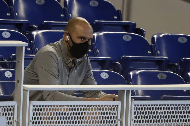 In this July 14, 2020, file photo, Miami Marlins CEO Derek Jeter watches the baseball team's practice in Miami.