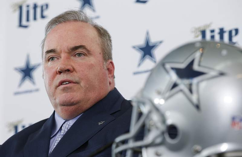 FILE - In this Wednesday, Jan. 8, 2020 file photo ,New Dallas Cowboys head coach Mike McCarthy is introduced during a press conference at the Dallas Cowboys headquarters in Frisco, Texas. Mike McCarthy has spent most of his first offseason as coach of the Dallas Cowboys at home in Green Bay. He's also leaning on the experience of 13 years leading the Packers to help figure out how to implement a new program while the coronavirus pandemic prevents him from being in the same room with players or assistant coaches. (AP Photo/Brandon Wade, File)