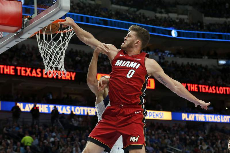 FILE - In this Dec. 14, 2019, file photo, Miami Heat forward Meyers Leonard (0) dunks on Dallas Mavericks forward Kristaps Porzingis, obscured at rear, during the first half of an NBA basketball game in Dallas. Jusuf Nurkic is back and healthy. So are Zach Collins, Meyers Leonard, Giannis Antetokounmpo, Anthony Davis and plenty of others. If the four-month NBA shutdown had a silver lining, its that a lot of ailing players got well.  (AP Photo/Michael Ainsworth, File)