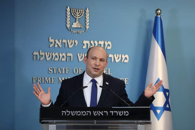 Israeli Prime Minister Naftali Bennett speaks during a news conference regarding COVID-19 pandemic in the country on Wednesday, Aug. 18, 2021 in Jerusalem. (Abir Sultan/Pool Photo via AP)