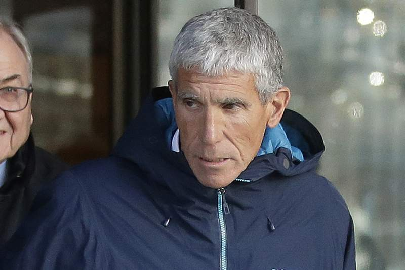 """FILE - In this March 12, 2019, file photo, William """"Rick"""" Singer, founder of the Edge College & Career Network, exits federal court in Boston after he pleaded guilty to charges in a nationwide college admissions bribery scandal. In a legal filing on Friday, April 24, 2020, prosecutors said the defense's claims that investigators bullied Singer, their cooperating witness, into lying in order to entrap actress Lori Loughlin, her husband Mossismo Giannulli and other parents were """"repugnant and untrue."""" (AP Photo/Steven Senne, File)"""