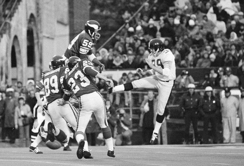 FILE - In this Jan. 12, 1975 file photo, Minnesota Vikings' Matt Blair (59) goes high to block the kick by Pittsburgh Steelers' Bobby Walden (39) during the fourth quarter of Super Bowl IX in New Orleans.  The Vikings say Blair, one of the great linebackers in team history, has died. Blair had been suffering from dementia.  (AP Photo/Jack Thornell, File)
