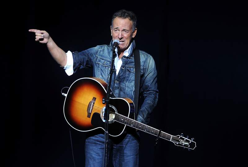 FILE - In this Nov. 5, 2018, file photo, Bruce Springsteen performs at the 12th annual Stand Up For Heroes benefit concert at the Hulu Theater at Madison Square Garden in New York. Iconic artists Lin-Manuel Miranda, Jon Bon Jovi and Bruce Springsteen are among the stars who will highlight a primetime virtual celebration televised Wednesday night following President-elect Joe Bidens inauguration.(Photo by Brad Barket/Invision/AP, File)