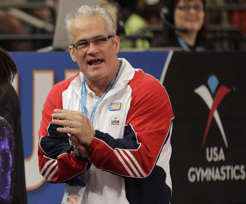 FILE - In this March 3, 2012, file photo, gymnastics coach John Geddert is seen at the American Cup gymnastics meet at Madison Square Garden in New York. Prosecutors in Michigan filed charges Thursday, Feb. 25, 2021, against Geddert, a former U.S. Olympics gymnastics coach with ties to disgraced sports doctor Larry Nassar. Geddert was head coach of the 2012 U.S. women's Olympic gymnastics team, which won a gold medal. (AP Photo/Kathy Willens, File)
