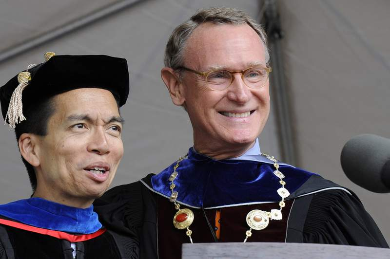 FILE - In this May 31, 2008, file photo, Rhode Island School of Design outgoing president Roger Mandle, right, introduces his successor John Maeda, left, during RISD's commencement in Providence, R.I. The school said Tuesday, Dec. 1, 2020, that Mandle, who served as president from 1993 to 2008, has died. He was 79. (AP Photo/Stew Milne, File)