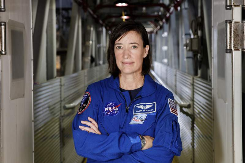 In this Tuesday, June 25, 2019 file photo made available by NASA, astronaut Megan McArthur poses for a portrait at the Kennedy Space Center in Florida. The space station astronaut is celebrating her 50th birthday with the coolest present ever _ a supply ship bearing ice cream and other treats. SpaceXs latest cargo delivery showed up Monday, Aug. 30, 2021 at the International Space Station after a day in transit. Overseeing the automated docking was NASA astronaut Megan McArthur. (Joel Kowsky/NASA via AP)