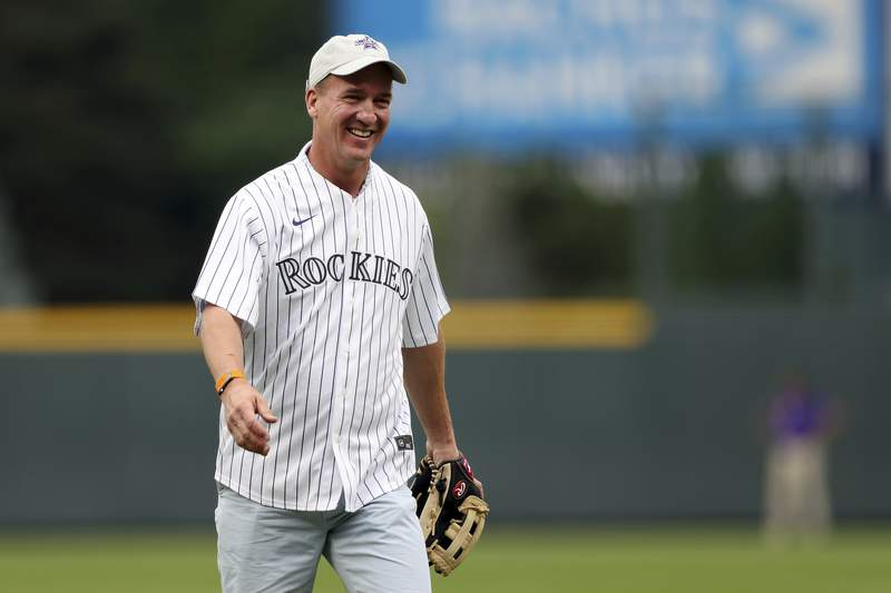 Peyton Manning smiles after throwing out the ceremonial first pitch prior to the 91st MLB baseball All-Star Game, Tuesday, July 13, 2021 in Denver. (AP Photo/Alex Trautwig, Pool)
