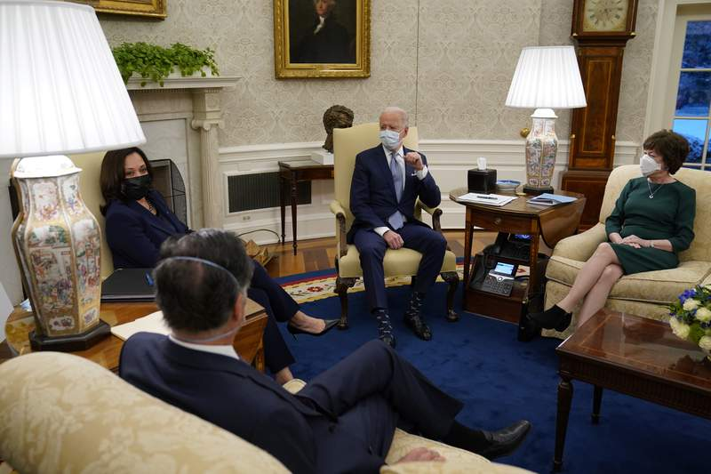 President Joe Biden meets with Sen. Susan Collins, R-Maine, right, Sen. Mitt Romney, R-Utah, and others to discuss a coronavirus relief package, in the Oval Office of the White House, Monday, Feb. 1, 2021, in Washington. (AP Photo/Evan Vucci)