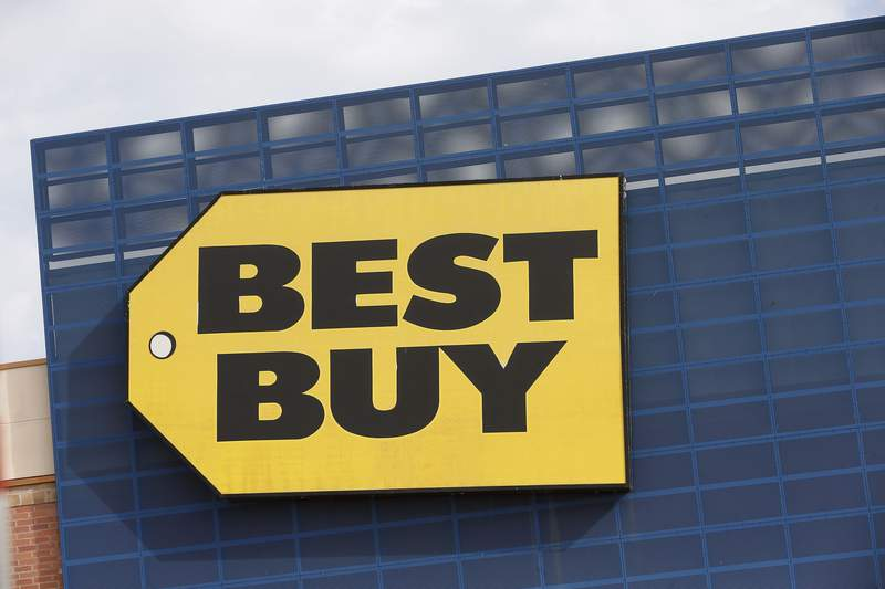 FILE - In this Aug. 27, 2019 file photo, the Best Buy logo is shown on a store in Richfield, Minn.  On Tuesday, Nov. 24, 2020, Best Buy Co. reported fiscal third-quarter results that blew through analysts expectations as the nations largest consumer electronics retailer  saw surging demand for items like home theater and appliances that help people learn, cook, work and connect in their homes during the pandemic.   (AP Photo/Jim Mone)
