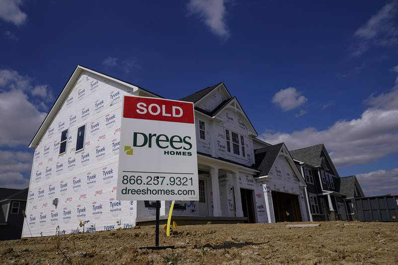 """FILE - In this Sept. 25, 2020 file photo, a """"sold"""" sign sits on a lot as new home construction continues in Westfield, Ind. Mortgage rates fell for the first time in more than two months as buyers continue to be stifled by high prices and limited supply. (AP Photo/Michael Conroy, File)"""
